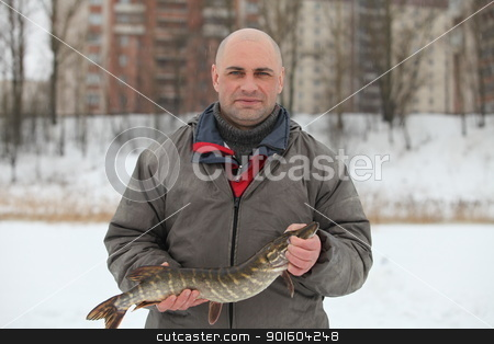 Fisherman stock photo, Fisherman caught a pike in the winter fishing by mrivserg