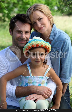 Parents and young daughter in the garden on a summer day stock photo, Parents and young daughter in the garden on a summer day by photography33