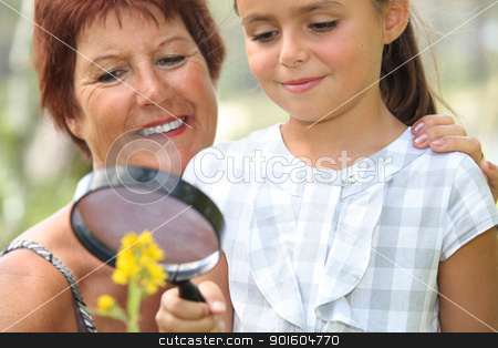 Girl with magnifying glass stock photo, Girl with magnifying glass by photography33