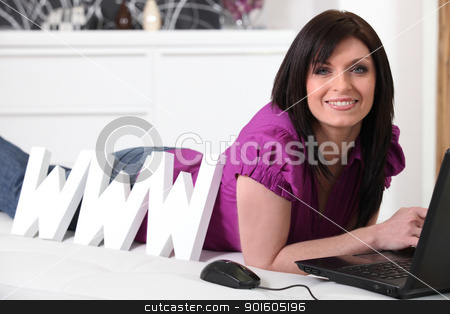 Woman laying next to large WWW letters stock photo, Woman laying next to large WWW letters by photography33