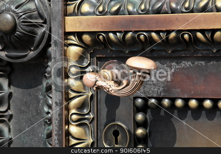 door  stock photo, fragment of antique brass door with ornaments, close-up by mrivserg