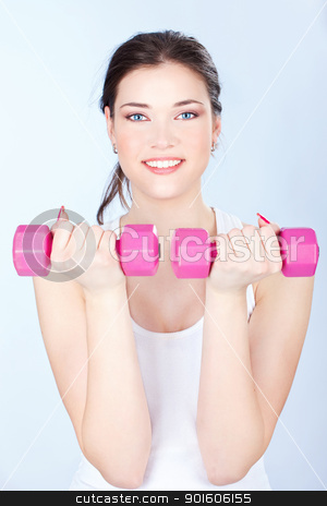 woman doing fitness exercises stock photo, Young woman doing fitness exercises by iMarin