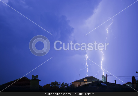 Lightening Roots At Night Striking Near House stock photo, Thunderstorm with lightening at night. by KonArt