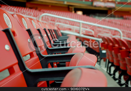 A Row of Red Stadium Seats stock photo, A photo of a row of stadium seats at Busch Stadium in St. Louis, Missouri.  Home of the St. Louis Cardinals.   by Andrew Thompson