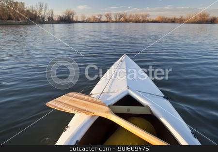 canoe bow and paddle stock photo, bow of white canoe with wooden paddle on a calm lake in Colorado by Marek Uliasz