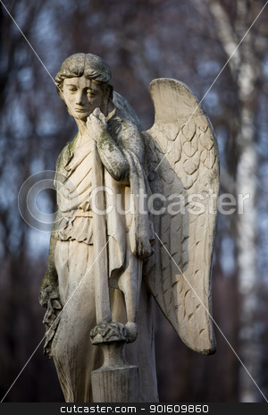 Angel Statue stock photo, 19th century statue of an angel with sad expression on face at Warsaw cemetery in Poland by Rognar