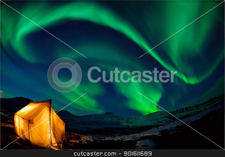 Northern lights stock photo, Camping in the north with the northern lights overhead (Aurora Borealis) by Steve Mcsweeny
