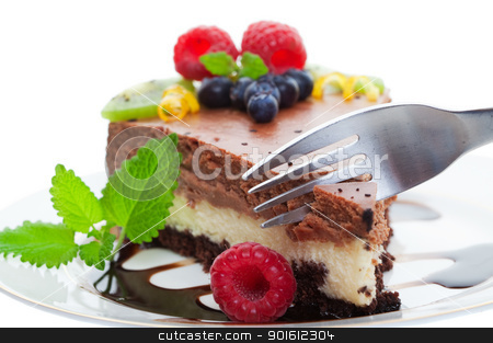 Chocolate cake macro stock photo, Fork cutting into a double decker chocolate cheese cake, Focus on fork shallow depth of field by Steve Mcsweeny