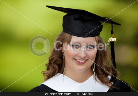 College graduate stock photo, Portrait of a pretty female university graduate  by Steve Mcsweeny