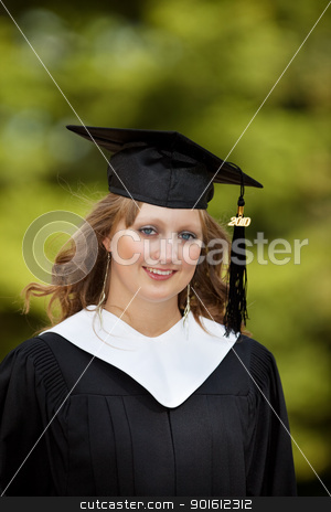 Graduate stock photo, Portrait of a pretty female college graduate by Steve Mcsweeny