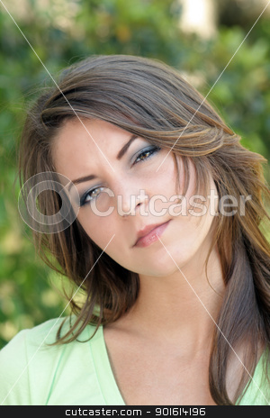Beautiful Young Brunette, Outdoor Headshot (4) stock photo, A close-up of a lovely young brunette with a serious facial expression. by Carl Stewart