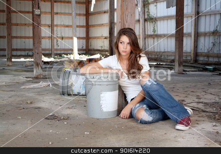 Beautiful Brunette Sitting in an Abandoned Warehouse (5) stock photo, A lovely young brunette in dress-down casual wear sits on the floor of a long-abandoned warehouse. by Carl Stewart