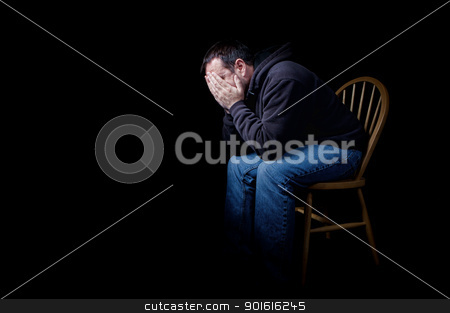 Depressed stock photo, A depressed man sitting in a chair with his hands over his face, shot on black by Steve Mcsweeny
