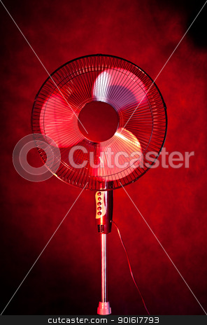office fan on dark red background stock photo, big office fan on dark red background by Petr Malyshev