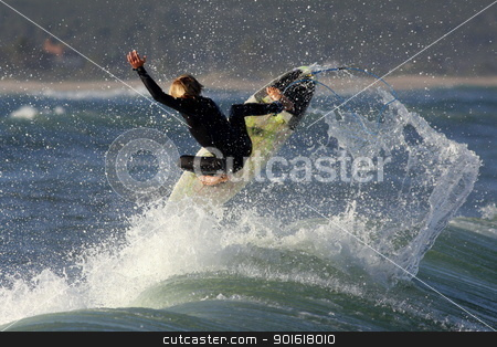 Surfer at Jeffreys Bay, South Africa stock photo, A top local surfer hits a air at Super tubes,one of the best right hand waves in the world. Situated in Jeffreys Bay, South Africa by Jonathan Pledger