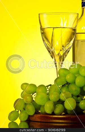 glass of white wine and grape stock photo, glass of white wine and grape, yellow background by Petr Malyshev