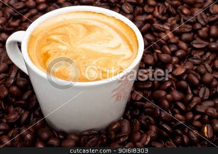 coffee cup with pattern on foam stock photo, coffee cup with pattern on foam, closeup by Petr Malyshev