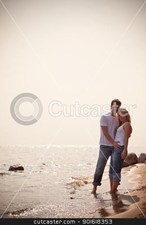 beautiful couple on a seashore stock photo, beautiful couple on a seashore, toned by Petr Malyshev