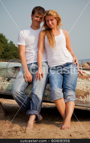 couple on a beach near old boat stock photo, beautiful couple on a beach near old boat by Petr Malyshev