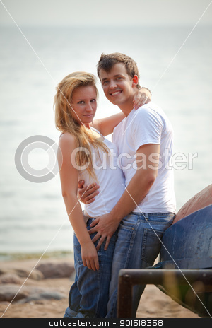 couple on a beach stock photo, beautiful couple on a beach by Petr Malyshev