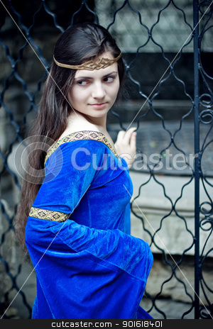medieval beauty stock photo, medieval beauty near metal gate by Petr Malyshev