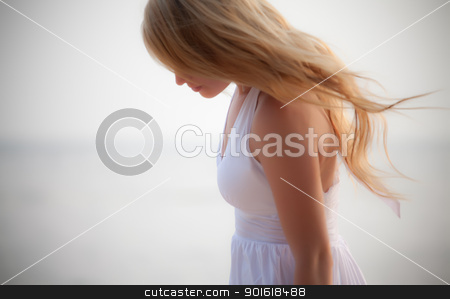 beautiful girl on seashore stock photo, beautiful girl on seashore, soft focus by Petr Malyshev