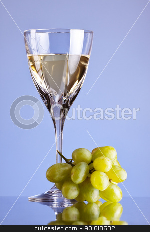 glass of white wine and grape stock photo, glass of white wine and grape, blue background by Petr Malyshev