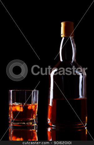 Whiskey Bottle And Glass stock photo, bottle and glass of whiskey on black background by Petr Malyshev