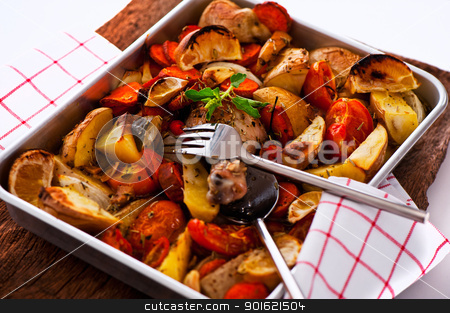 Chicken with vegetables on a baking tray as a studio shot stock photo, Chicken with vegetables on a baking tray as a studio shot by p.studio66