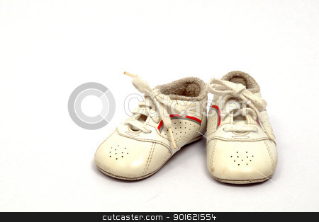 Baby shoes stock photo, Baby first sports shoes on white background by bigjom