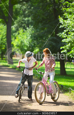Mother and Son in Park stock photo, mother and son in park at bicycle by Petr Malyshev