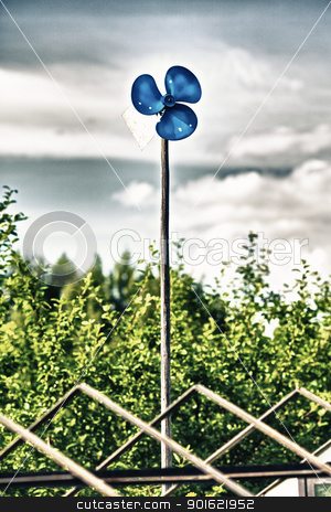Blue Garden Windmill stock photo, blue garden windmill against cloudy sky at summer day by Petr Malyshev