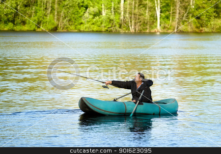 Fisherman in Rubber Boat stock photo, man fishing in rubber boat on a lake by Petr Malyshev