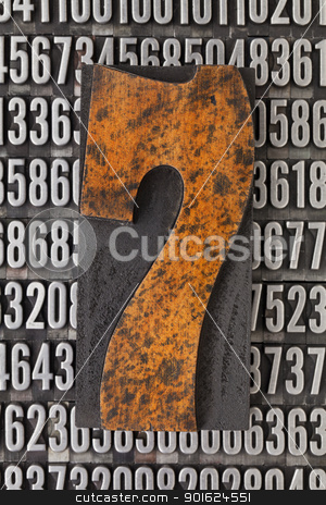 number seven abstract stock photo, number seven in vintage letterpress wood type against background of random metal numbers by Marek Uliasz