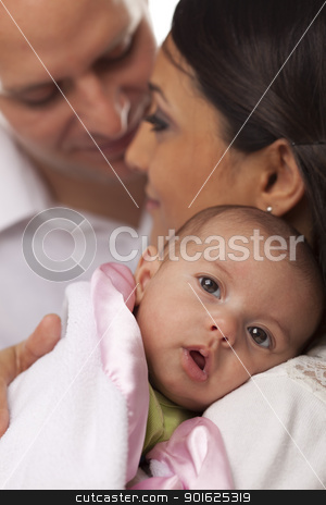 Mixed Race Young Family with Newborn Baby stock photo, Happy Young Attractive Mixed Race Family with Newborn Baby. by Andy Dean