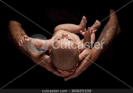 Hands of Father and Mother Hold Newborn Baby on Black stock photo, Hands of Father and Mother Hold Newborn Baby Under Dramatic Lighting Against A Black Background. by Andy Dean