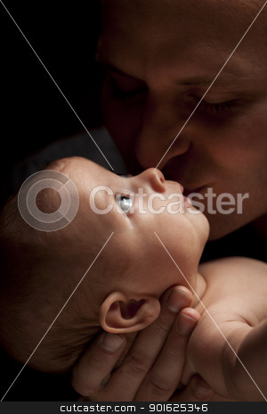 Young Father Holding His Mixed Race Newborn Baby stock photo, Happy Young Father Holding His Mixed Race Newborn Baby Under Dramatic Lighting. by Andy Dean