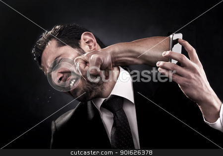 Angry call stock photo, Employee gets punched through smart phone by angry unsatisfied client because of bad service, product, behavior, or attitude by Zaid Saadallah