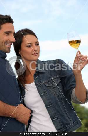 Couple tasting wine in field stock photo, Couple tasting wine in field by photography33