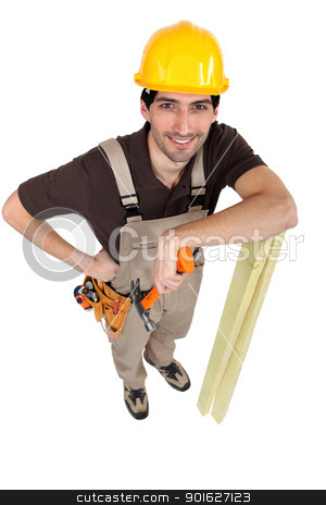 Builder posing with his tools and building supplies stock photo, Builder posing with his tools and building supplies by photography33