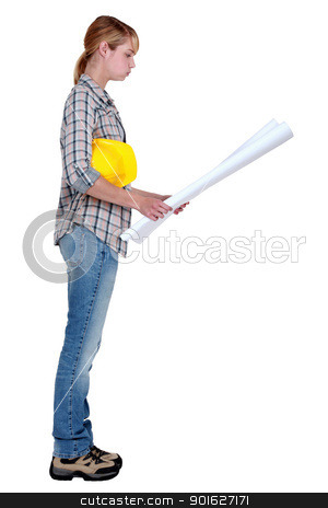 Female builder with plans stock photo, Female builder with plans by photography33
