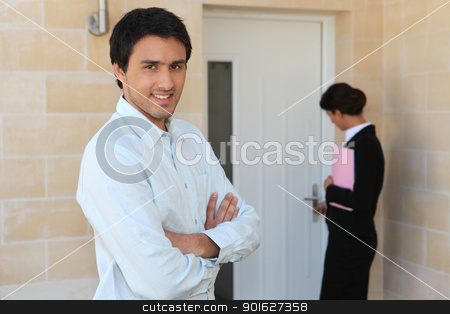 Estate agent showing man around property stock photo, Estate agent showing man around property by photography33