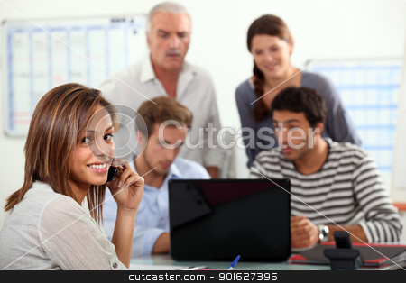 woman advising a group  of people possibly a family stock photo, woman advising a group  of people possibly a family by photography33