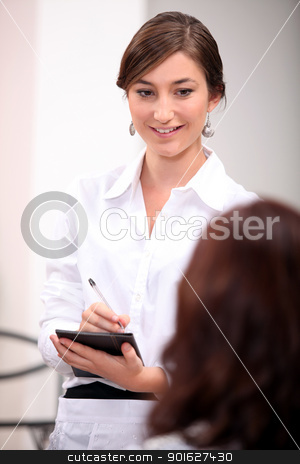 A businesswoman taking notes. stock photo, A businesswoman taking notes. by photography33
