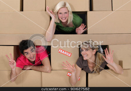 Three people surrounded by boxes stock photo, Three people surrounded by boxes by photography33