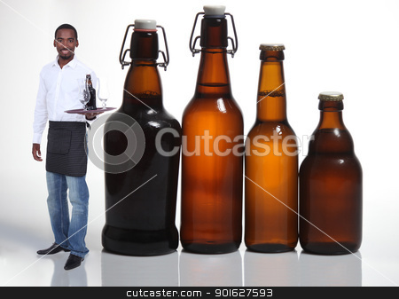 Waiter with beer bottles stock photo, Waiter with beer bottles by photography33