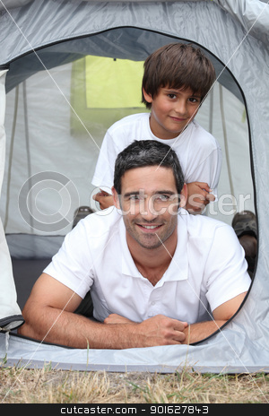 Father and son in a tent stock photo, Father and son in a tent by photography33