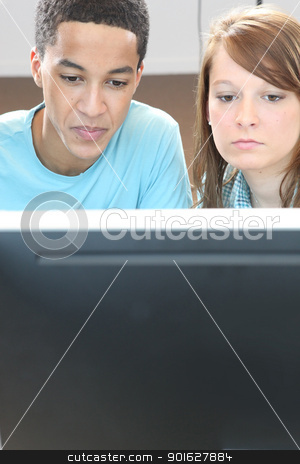 Two teenagers in front of computer stock photo, Two teenagers in front of computer by photography33