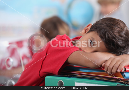 sleepy boy in classroom stock photo, sleepy boy in classroom by photography33