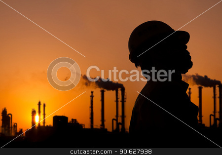the silhouette of oil refinery worker at sunset stock photo, the silhouette of oil refinery worker at sunset by tomwang
